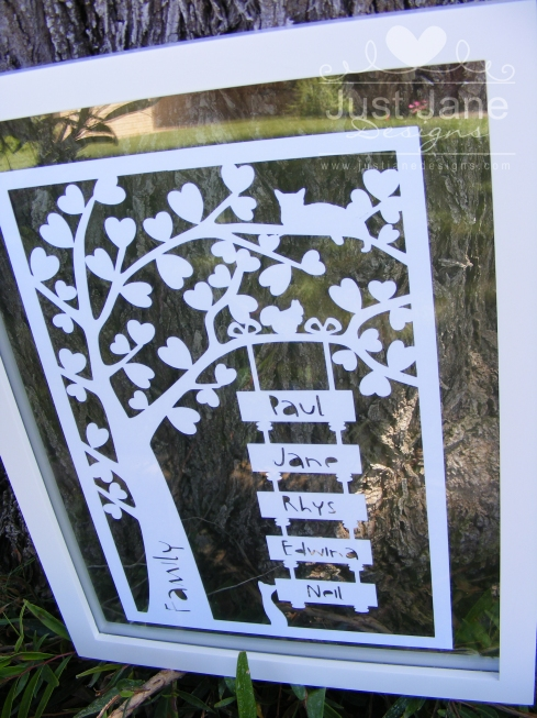 Finished Family Tree paper cut under our family tree! (It had to be done)